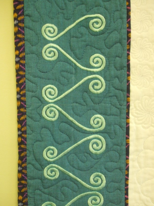 The side borders were 3 GR hoopings each sing clothsetter & printed templates to line up the designs