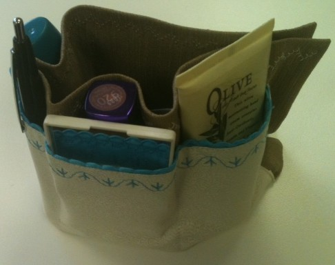 "PURSE ORGANIZER stocked with all sorts of ladies' purse ""clutter"""