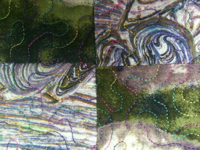HERE IS A QUILT WHICH WAS STIPPLED IN THE ACUFIL HOOP USING A VARIGATED RAYON THREAD - CAN GIVE A VERY PRETTY RESULT.