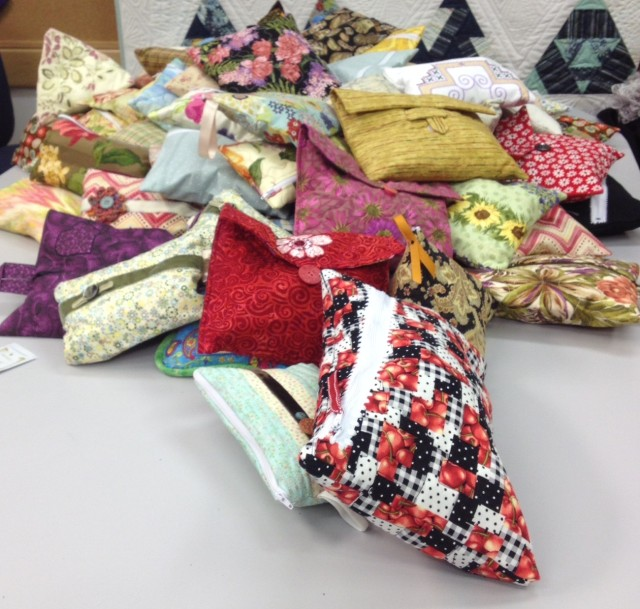 SOME OF THE 161 BAGS THAT WERE MADE & FILLED WITH DONATED TOILETRIES; TOOTHBRUSHES, TOOTHPASTES ETC