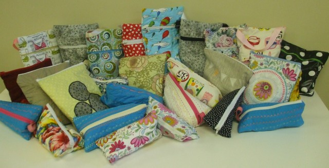 About half of these bags were made by staff & customers at THE QUILTED BEAR in LADNER, BC. The rest were rustled up by me during a bumper bag sewing frenzy during the summer! As I can make a bag in about 15 -20 minutes (not counting the embellishment) it does go pretty quickly!