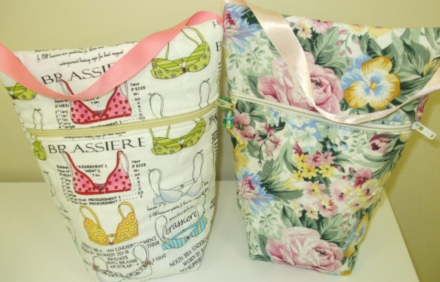 isn't this a lovely bag design: has a zipper about 2/3 of the way up one side & a little ribbon handle to carry it. Thank you to the ladies at THE QUILTED BEAR  for these bags.  And what fun fabrics!