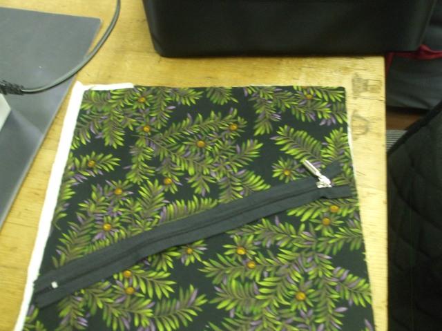 This is where you start: fabric sandwich + zipper.