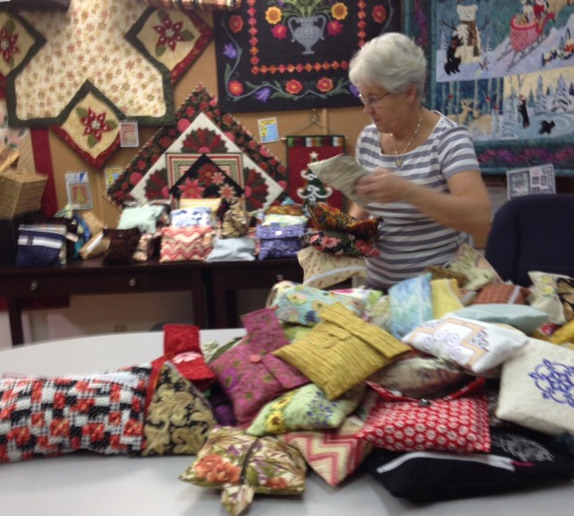 EILEEN IS HARD AT WORKING HELPING PACK THE BAGS BEFORE DELIVERY TO THE HAVEN IN NANAIMO