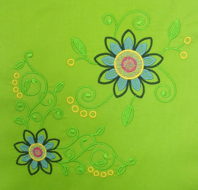 CORNER FLOWER SWIRL AND ANOTHER FLOWER SWIRL - you have see this satin stitch digitizing to believe how fine it is!