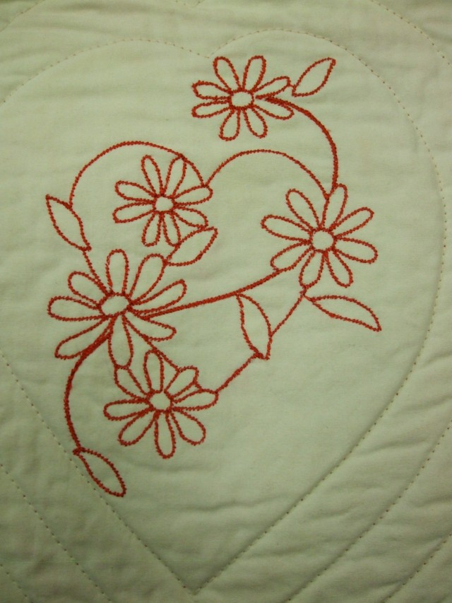 A close-up of the red work design. I quite liked the stem stitch variation instead of the more simple run line.