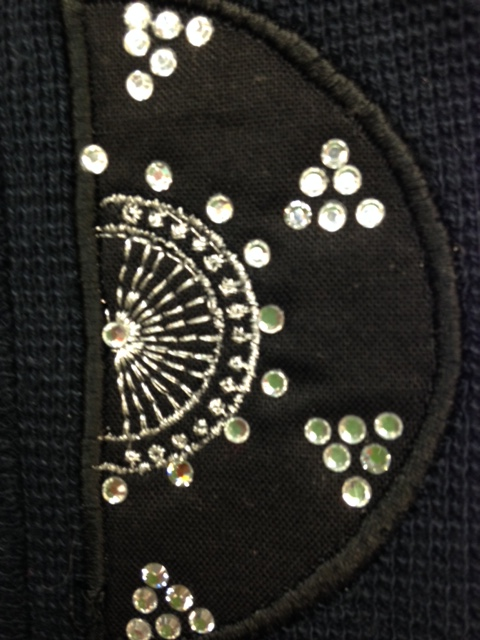 Here is a close-up of the embroidery with crystals added: please refer to previous blog posts on this topic as well as the link above to ARTISTIC SEWING SUITE.  Irene repeated the embroidery designs around the jacket band. each one was appliqued and embroidered in-the-hoop. Crystals were added the EASY Artistic crystals way afterwards.