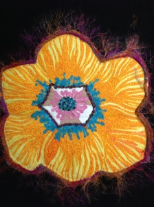 Or take one large fussy cut floral emblem and free motion all over with thread painting to create your own spring fantasy......this was for a class I taught a few years ago.