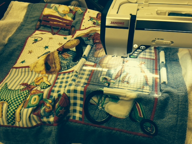 Linda P asked me to acufil quilt this baby quilt between answering questions and doing machine demo's on the booth........well we were so busy, I don't think I got even 1/3 of the way done....sorry, Linda but you will have to finish it!