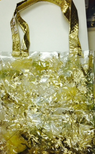 """Yet another bag using the same technique but this time chopped up pieces of gold lame fabric and organza was sandwiched between the 2 layers to make a """"flashy"""" tote bag. Straps were strips of gold lame fabric reinforced with cutaway stabilizer."""