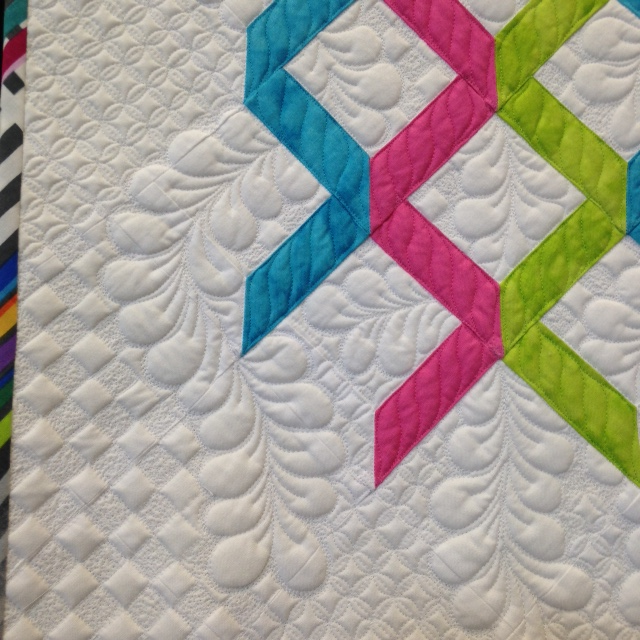 This was one of the entries in the Trentex Challenge which is held each year. It is entitled Ribbons of Niagara and was made by Joanne Love of Whitehorse, Yukon. She wanted to make a modern quilt that would reflect the Wonders of Niagara. The ribbons are to represent the falling water.