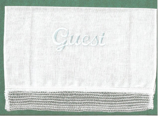 This Betty's Guest towel edged with pretty serger lace as well as Guest embroidered onto the fabric which looks like linen.