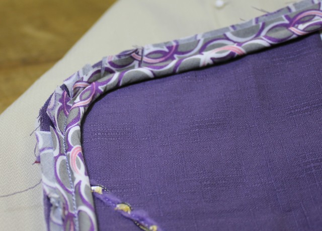 I like to sew my piping down onto my project (in this case it was a pillow) FIRST to hold it firmly in place. This could be done with a basting stitch if preferred. THEN I add the pillow back fabric on top & once more use the JANOME PIPING FOOT  to ride along the cord within the seam so that my stitching to hold all the layers together is correctly placed.