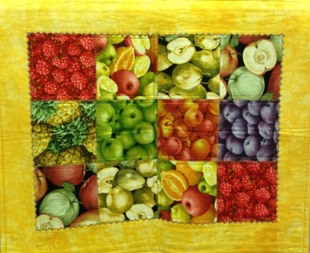 And fruit topper #2: same technique, different quilting stitches in the ditch and in the border.  This one is about the perfect size for a tray or coffee table.