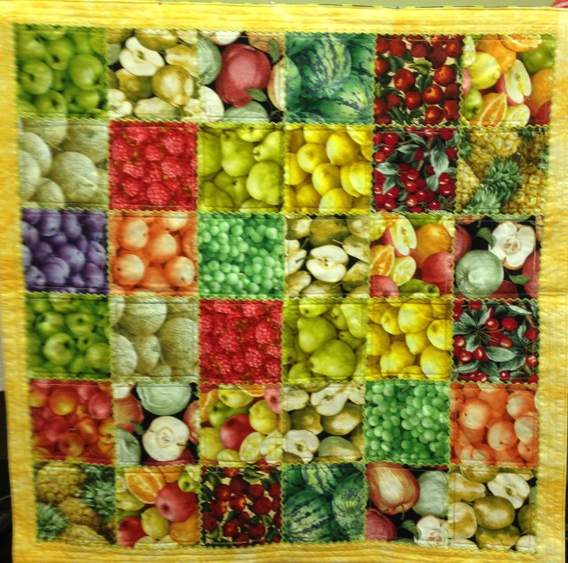Quilt topper #1 was made with an array of 5 inch/charm square sized pieces of fruit fabric.......and yes, there ARE apples liberally sprinkled throughout.
