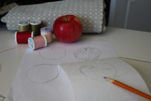 Practice drawing your apple on paper and then sketch a rough outline on your background