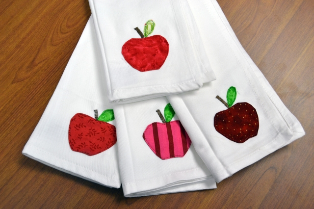 Dinner for 4? 6? 8? These store bought napkins get the custom-stitched treatment with Apple Applique