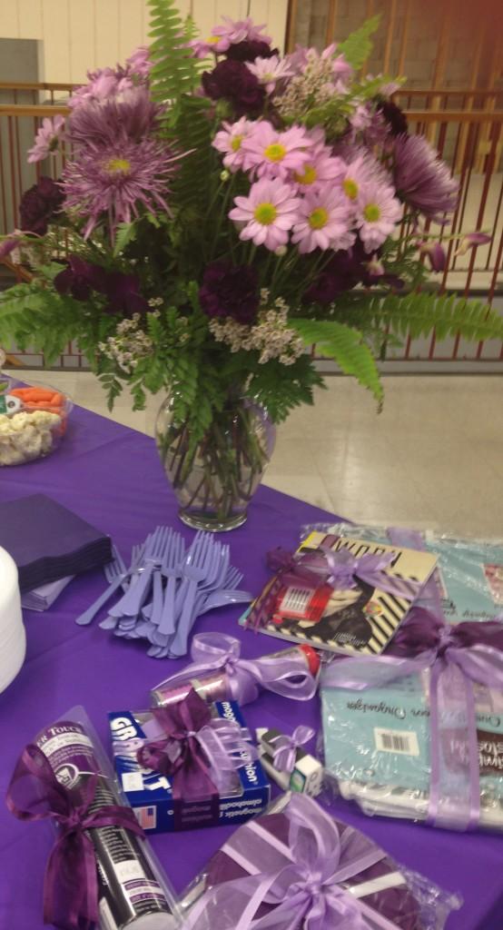 Purple flowers...door prizes.....even purple spoons for the goodies.