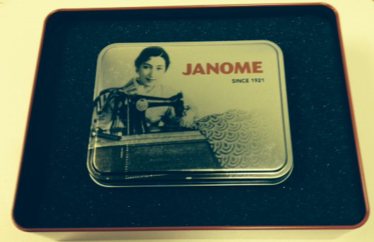 The inner smaller tin has our vintage Japanese sewing lady with Janome since 1921 on the lid