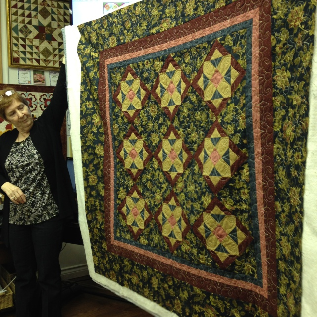 Donna holding up another of her close to completed creations.....also quilted using the ASQ22 Acufil hoop on the JANOME MC15000