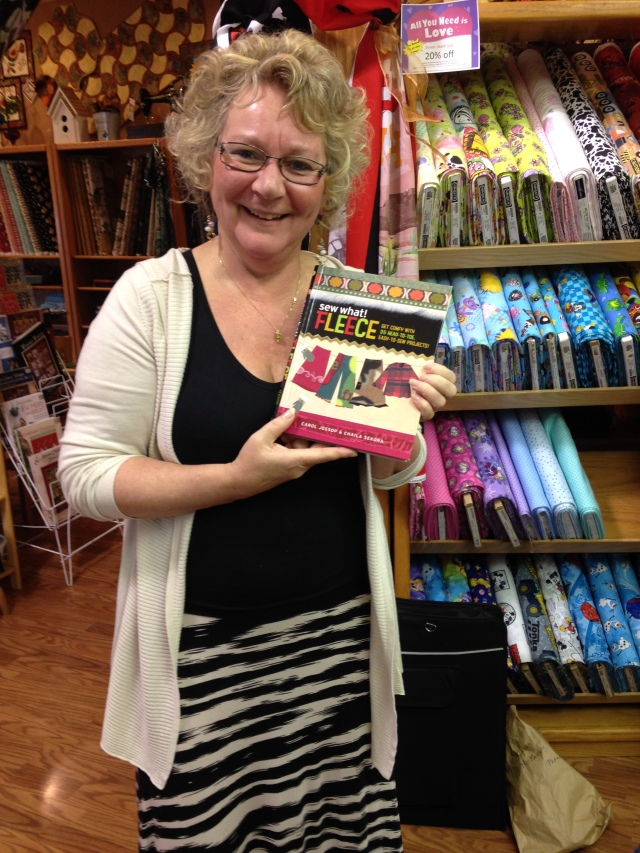 Kathy is the owner of Snip and Stitch Sewing Centre.  She is holding up the janomelife book giveaway that Doreen won at the end of January in our blog draw.