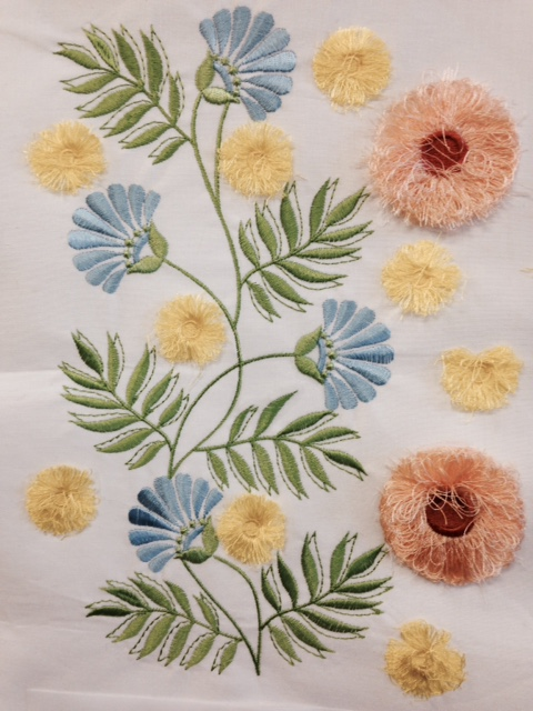 close up of our GR hoop design with fringed flowers