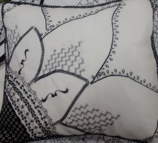 A sunflower  doodled  cut in half to form 1 pillow of a pair....we love it , Nancy.