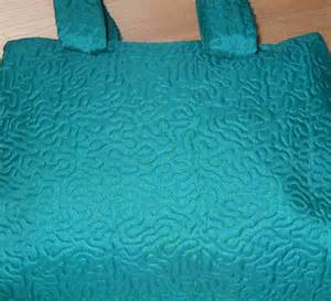 A bag which was stippled all over using the Acufil quilting system