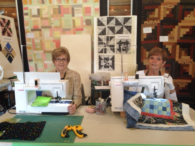 These 2 ladies were busy doing quilt demo's at the Quilt show and guess what machines they were sewing on?!