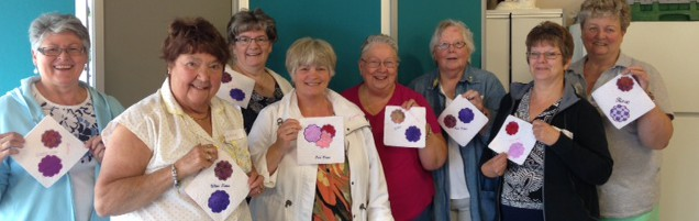 Customers at Linda's Quilt Shoppe in Kelowna showing off their mug rugs
