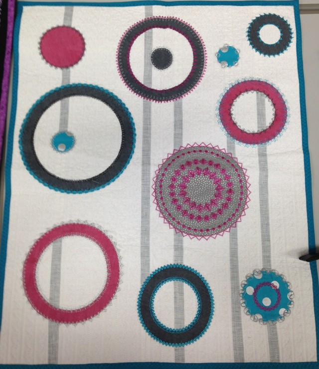 """Don't know about you but I have a """"thing"""" for circles....this mini quilt was just lovely: circles, circles, circles.....appliques cut with the Edge Cutter and dec stitched with the Janome Circular attachment"""