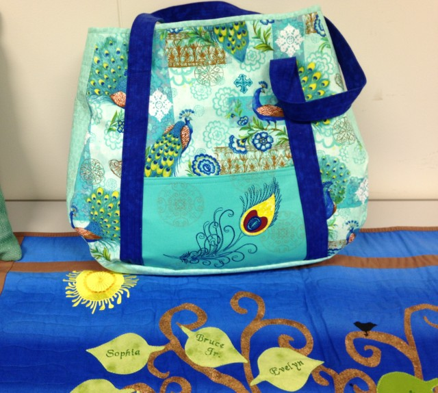 The lovely peacock embroidery design used on a larger tote bag