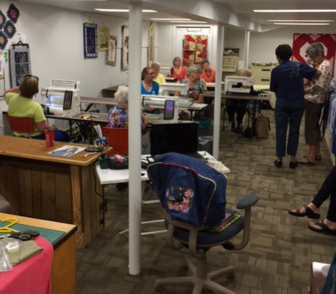 A hive of creative activity in the classroom at Sew &save Center, Stratford.