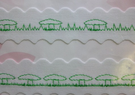 Two different mushroom stitches I had fun making - one with long grass and one with mowed grass! I used the image above as a back drop to help me make the mushroom shapes.
