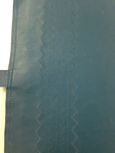 A couple of extra rows of dec. stitching on this cover - you can have fun and devise your own embellishment.