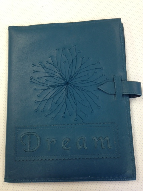 On this cover, I embroidered the word dream on a separate piece of faux leather & then stitched it onto the cover.... creative options!