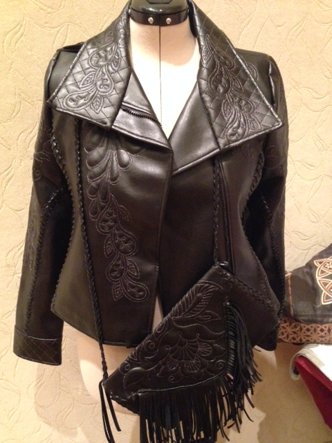 The jacket complete with matching bag with tassles!