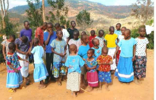 A group of happy Kenyan children showing off their new clothing!