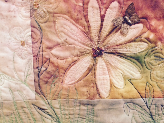 Another quilt by Anne Marie Irving: fabric has been hand painted, and then embellished with free motion quilting thread painting