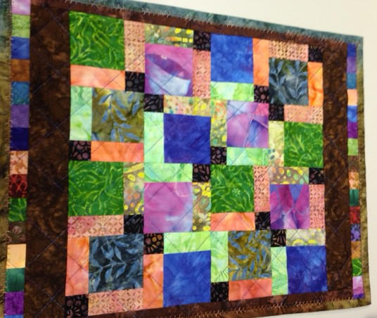 This is a large placemat that Diane at Snip and Stitch in Nanaimo made. She was susing up all her scraps and was having fun in the process. The next pic shows the other side of the placemat so it is fully reversible.