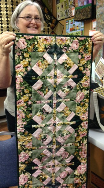 And here is Heather again: this time she is showing her first quilt she made using the Acuifil quilting tool and ASQ22 hoop on her Janome Mc15000