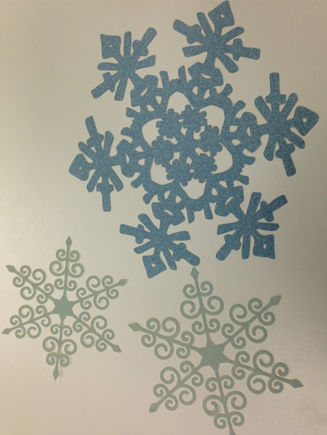 Intricate snowflakes cut from different sheets of cardstock