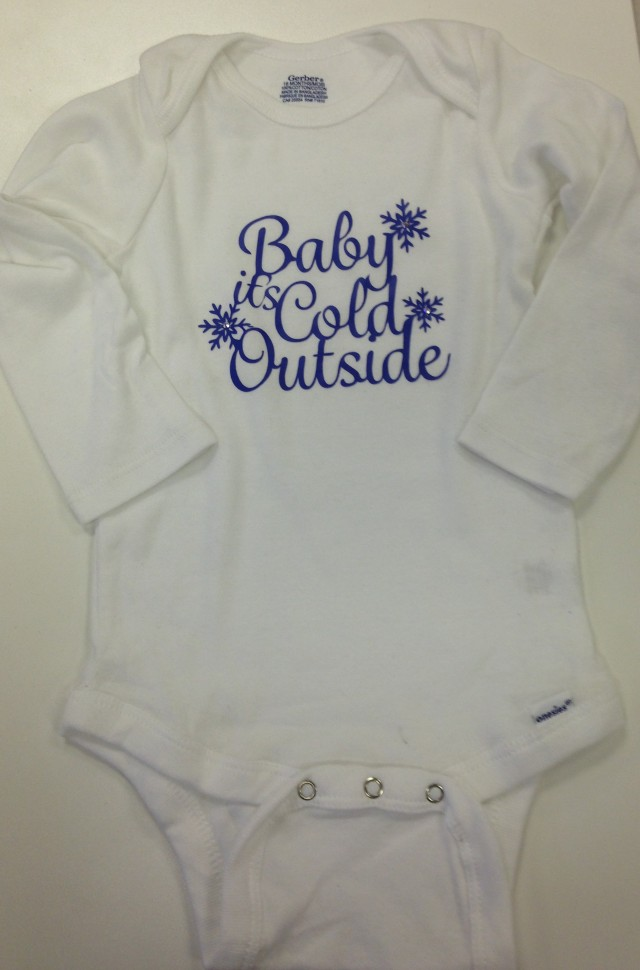 The cutest little onsie embellished with iron-on vinyl and crystals - Would you cut that all out with an X-acto knife of scissors? Me neither...but with our Artistic cutter it is fast and super easy.