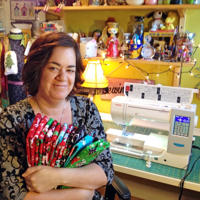 Cynthia with a bundle of fabrics destined for gift projects and her Janome MC8200