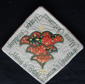 Christmas coaster using a Janome Sewing machine, software and digital cutter.
