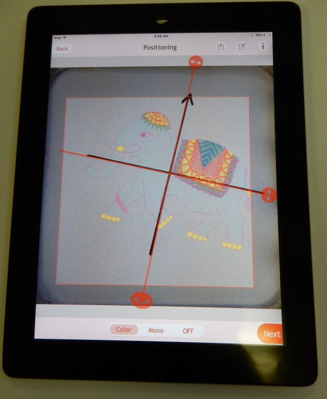 This is a pic of the iPad showing the MC15000 built-in elephant design beautiffuly lined up with the black cross hair marking  which was deliberately placed at an angle. NO need to fuss with hooping and rehooping to get placement just perfect..... the Acusetter APP does it efficiently and quickly. Also refer to link below for step-by-step instructions of how this very slick tool works.