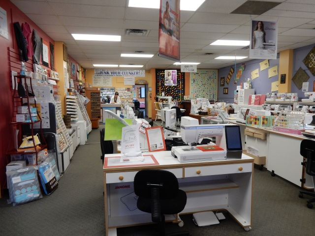 Johnson's Sewing Center in Edmonton with our Janome Mc15000 in the front of the pic.