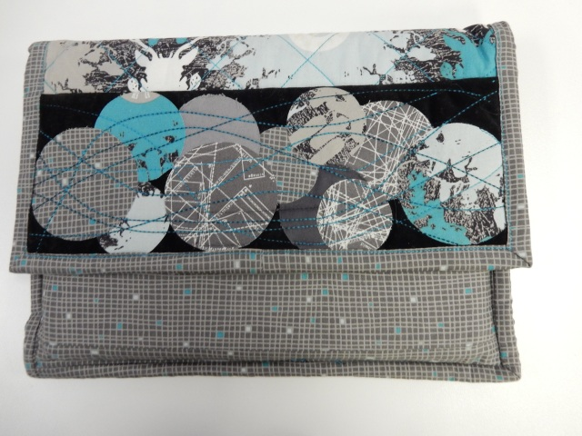 This practical iPad or tablet case/cover is made entirely on a SERGER.....yes, you heard correctly!
