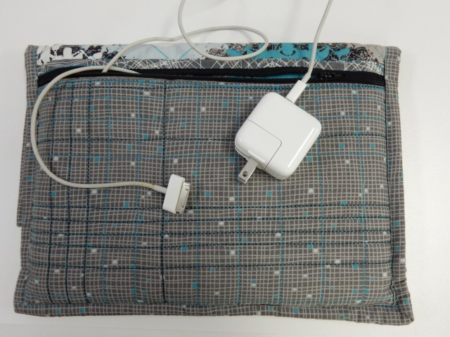 The back of the case has a large zippered pocket. The pocket was quilted with serger chain stitch too AND the zipper was inserted using chain stitch. Who said you cant use a serger for LOTS of regular sewing?
