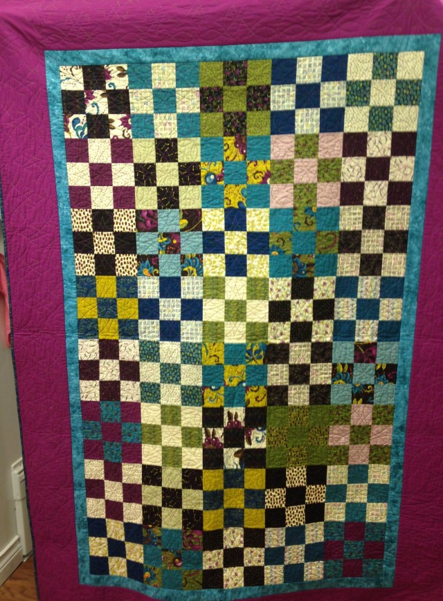 I did not want to believe Lillian when she told us that this was her very first quilt. She took the class at Snip and Stitchto make the quilt as well as learn how to use her Janome MC15000 with its incredible ACUFIL QUILTING SYSTEM to quilt the entire quilt. WELL DONE, Lillian!